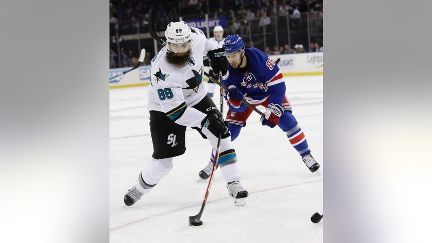 San Jose Sharks's Brent Burns (88) shoots the puck past New York Rangers's Josh Jooris (86) during the first period of an NHL hockey game, Monday, Oct. 17, 2016, in New York. (AP Photo/Frank Franklin II)