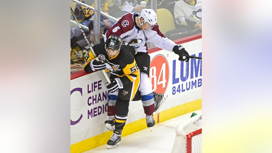 Pittsburgh Penguins defenseman Kris Letang (58) checks Colorado Avalanche defenseman Erik Johnson (6) during the third period of an NHL hockey game on Monday, Oct. 17, 2016, in Pittsburgh. (AP Photo/Fred Vuich)