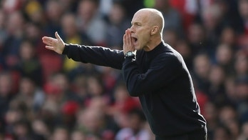 Swansea manager Bob Bradley looks across the pitch during the English Premier League soccer match between Arsenal and Swansea City at The Emirates Stadium in London, Saturday Oct. 15, 2016. (AP Photo/Tim Ireland)