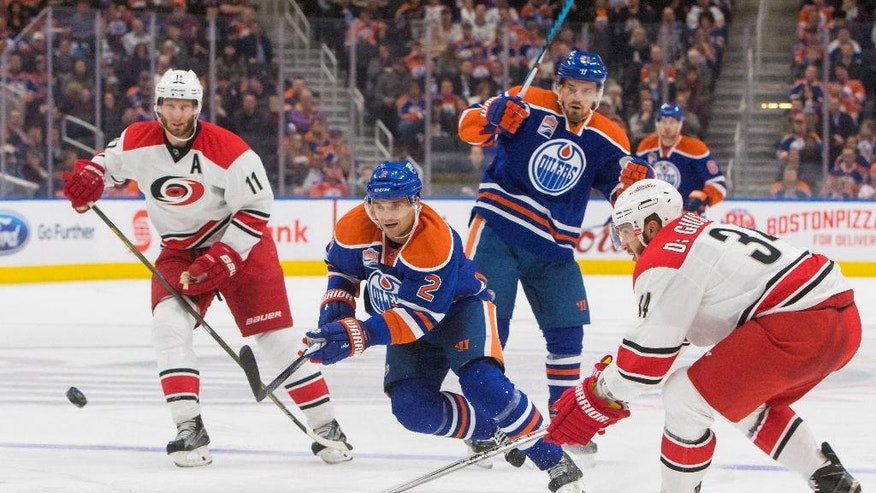 Carolina Hurricanes' Phil Di Giuseppe (34) and Jordan Staal (11) get in front of Edmonton Oilers' Andrej Sekera (2) as Oilers' Andrew Ference (21) watches during the second period of an NHL hockey game Tuesday, Oct. 18, 2016, in Edmonton, Alberta. (Amber Bracken/The Canadian Press via AP)