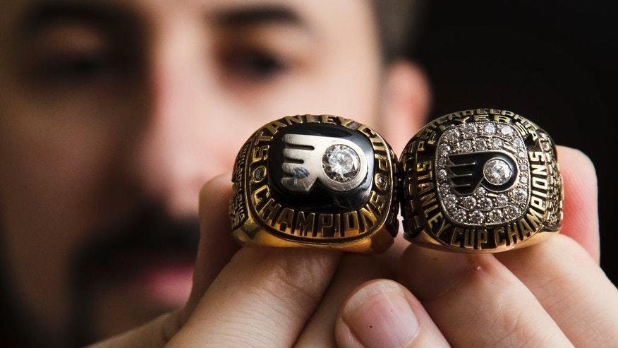Philadelphia Flyers archives manager Brian McBride displays Flyers Stanley Cup rings in Philadelphia, Wednesday, Oct. 19, 2016. The Flyers play their first home opener without founder Ed Snider on Thursday. Headed into 50 years of hockey in Philly, the Flyers hope to make this season memorable. (AP Photo/Matt Rourke)