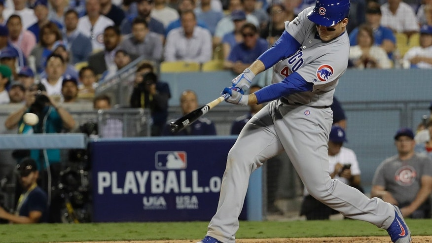 Oct. 19, 2016: Chicago Cubs' Anthony Rizzo hits a two-run scoring single during the sixth inning of Game 4 of the National League baseball championship series against the Los Angeles Dodgers in Los Angeles