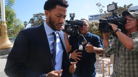 New York Knicks basketball player Derrick Rose arrives at U.S. District Court in downtown Los Angeles on Thursday, Oct. 6, 2016. A six-woman, two-man jury has been seated in the trial of a civil lawsuit brought against Derrick Rose by an ex-girlfriend who alleges the NBA star and two of his friends drugged and sexually assaulted her. (AP Photo/Damian Dovarganes)