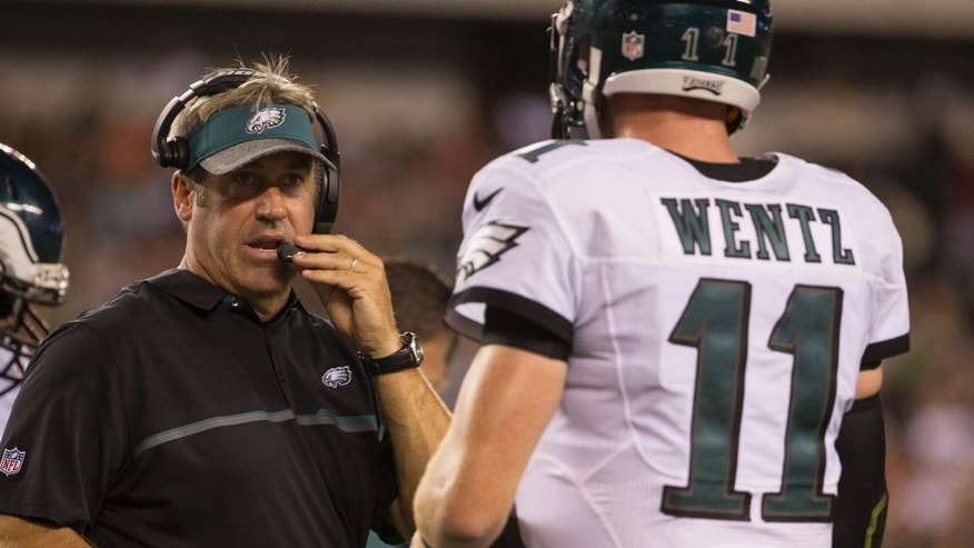 PHILADELPHIA, PA - AUGUST 11: Head coach Doug Pederson of the Philadelphia Eagles talks to Carson Wentz #11 during a timeout in the game against the Tampa Bay Buccaneers at Lincoln Financial Field on August 11, 2016 in Philadelphia, Pennsylvania. The Eagles defeated the Buccaneers 17-9. (Photo by Mitchell Leff/Getty Images)