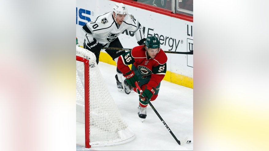 Los Angeles Kings' Tanner Pearson, center, pursues Minnesota Wild's Erik Haula of Finland in the first period of an NHL hockey game Tuesday, Oct. 18, 2016, in St. Paul, Minn. Both players scored goals in the first period. (AP Photo/Jim Mone)