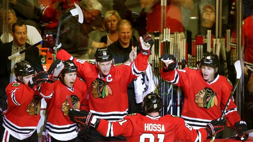 Chicago Blackhawks' Marian Hossa (81) celebrates his 500th career goal with teammates during the second period of an NHL hockey game against Philadelphia Flyers on Tuesday, Oct. 18, 2016, in Chicago. (AP Photo/Charles Rex Arbogast)