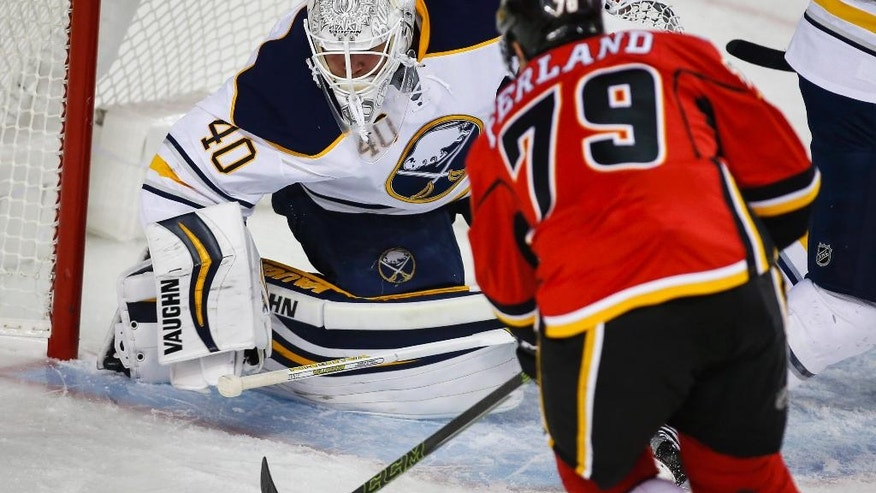 Buffalo Sabres goalie Robin Lehner, left, from Sweden, blocks the net in front of Calgary Flames' Micheal Ferland during the first period of an NHL hockey game Tuesday, Oct. 18, 2016, in Calgary, Alberta. (Jeff McIntosh/The Canadian Press via AP)