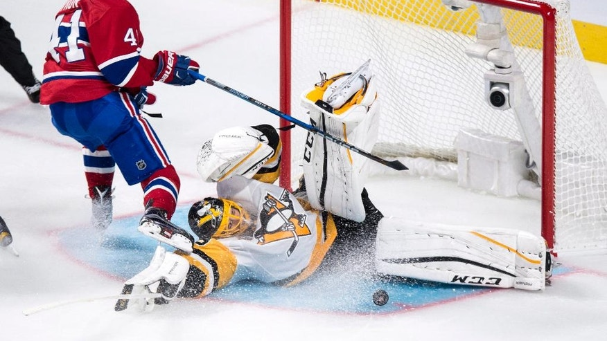 Pittsburgh Penguins goalie Marc-Andre Fleury makes a save off Montreal Canadiens' Paul Byron during second period NHL hockey action, Tuesday, Oct. 18, 2016 in Montreal. (Paul Chiasson/The Canadian Press via AP)