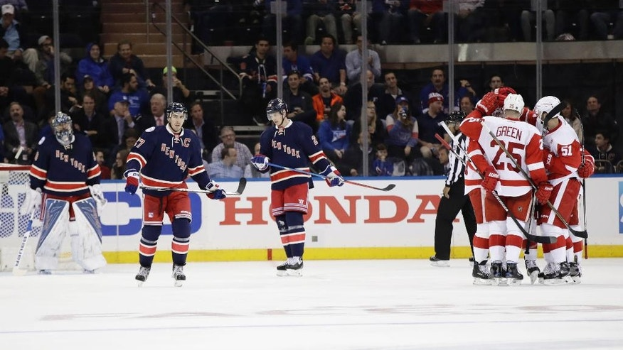 The Detroit Red Wings celebrate a goal by Thomas Vanek during the second period of an NHL hockey game as New York Rangers goalie Henrik Lundqvist, left, stands in front of the goal Wednesday, Oct. 19, 2016, in New York. (AP Photo/Frank Franklin II)