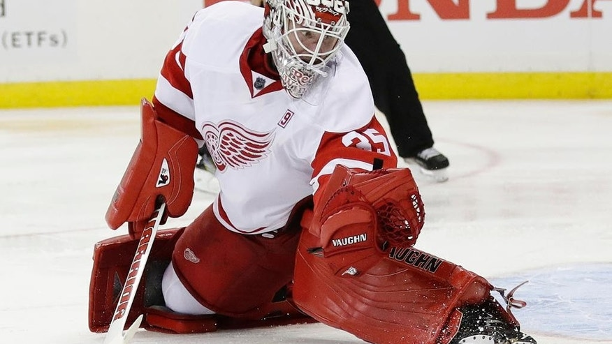 Detroit Red Wings goalie Jimmy Howard (35) stops a shot during the second period of the team's NHL hockey game against New York Rangers on Wednesday, Oct. 19, 2016, in New York. (AP Photo/Frank Franklin II)