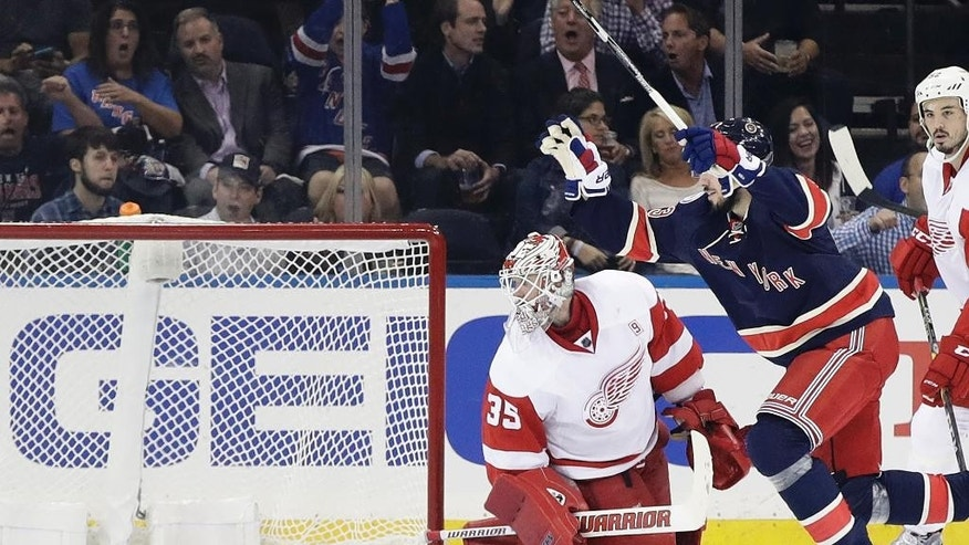 Detroit Red Wings goalie Jimmy Howard (35) watches a shot by New York Rangers' Mika Zibanejad get past him for a goal during the first period of an NHL hockey game Wednesday, Oct. 19, 2016, in New York. (AP Photo/Frank Franklin II)
