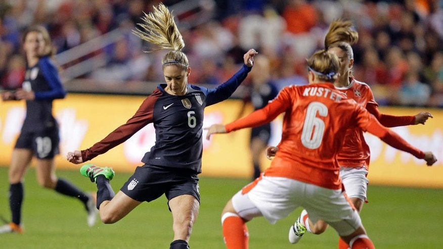 United States' Morgan Brian (6) kicks the ball as Switzerland's Selina Kuster (6) defends during the first half during an international friendly soccer match Wednesday, Oct. 19, 2016, in Sandy, Utah. (AP Photo/Rick Bowmer)