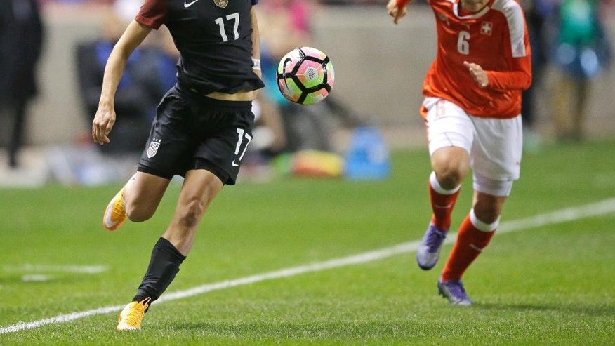 United States' Tobin Heath controls the ball as Switzerland's Selina Kuster (6) closes in during the first half during an international friendly soccer match Wednesday, Oct. 19, 2016, in Sandy, Utah. (AP Photo/Rick Bowmer)