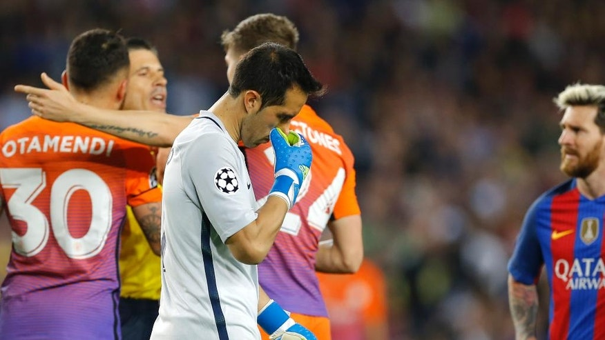 Manchester City's goalkeeper Claudio Bravo leaves the pitch after being shown a red card for handling the ball outside the box during a Champions League, Group C soccer match between Barcelona and Manchester City, at the Camp Nou stadium in Barcelona, Wednesday, Oct. 19, 2016. (AP Photo/Francisco Seco)