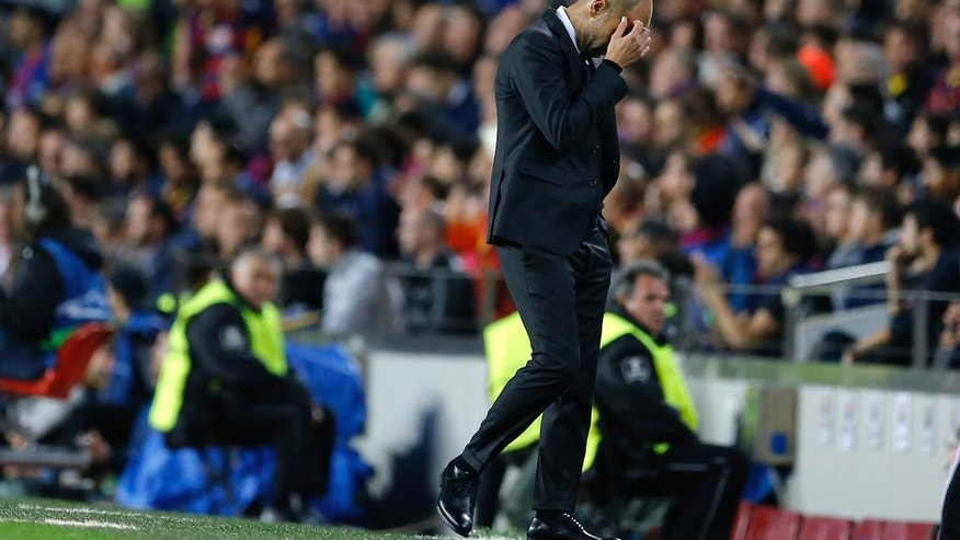 Manchester City's manager Pep Guardiola walks on the sidelines during a Champions League, Group C soccer match between Barcelona and Manchester City, at the Camp Nou stadium in Barcelona, Wednesday, Oct. 19, 2016. (AP Photo/Francisco Seco)