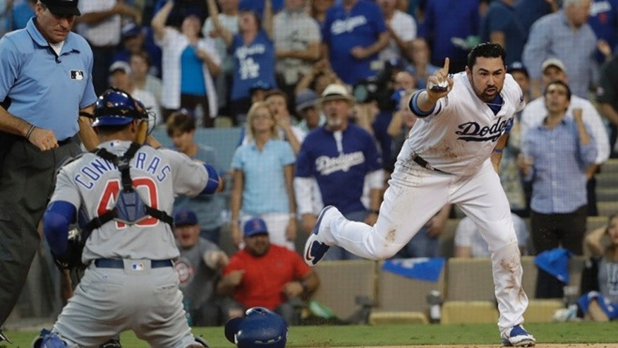 Los Angeles Dodgers' Adrian Gonzalez reacts after being called out at home during the second inning of Game 4 of the National League baseball championship series against the Chicago Cubs Wednesday, Oct. 19, 2016, in Los Angeles. Gonzalez tried to score from second on a hit by Andrew Toles. (AP Photo/David J. Phillip)