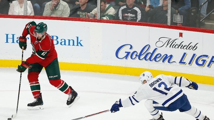 Minnesota Wild's Eric Staal moves the puck against the Toronto Maple Leafs' Connor Brown in the first period of an NHL hockey game Thursday, Oct. 20, 2016, in St. Paul, Minn. (AP Photo/Stacy Bengs)