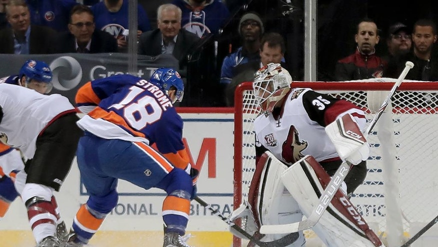 New York Islanders right wing Ryan Strome (18) scores a goal against Arizona Coyotes goalie Louis Domingue (35) during the first period of an NHL hockey game, Friday, Oct. 21, 2016, in New York. (AP Photo/Julie Jacobson)