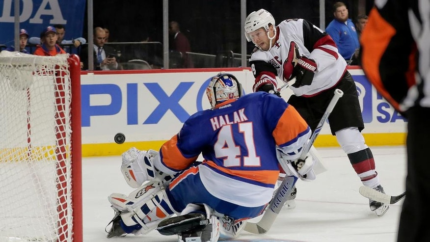 New York Islanders goalie Jaroslav Halak (41) blocks a shot by Arizona Coyotes right wing Shane Doan (19) during the first period of an NHL hockey game, Friday, Oct. 21, 2016, in New York. (AP Photo/Julie Jacobson)