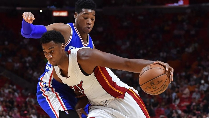 Oct 21, 2016; Miami, FL, USA; Miami Heat center Hassan Whiteside (21) controls the ball around Philadelphia 76ers forward Richaun Holmes (22) during the second half at American Airlines Arena. The Philadelphia 76ers defeat the Miami Heat 113-110. Mandatory Credit: Jasen Vinlove-USA TODAY Sports