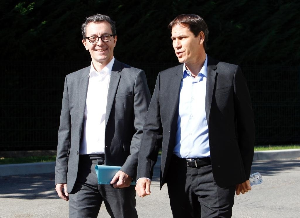 Marseille's new coach Rudi Garcia, right, and Marseille's new President Jacques-Henri Eyraud arrive at a press conference in Marseille, southern France, Friday, Oct. 21, 2016. Rudi Garcia has been appointed as Marseille's new coach ahead of Sunday's league game against bitter rival Paris Saint-Germain. Three days after American businessman Frank McCourt completed his takeover of the southern club, Marseille said on Thursday that Garcia will be in charge for the biggest game in French football at Parc des Princes. (AP Photo/Claude Paris)