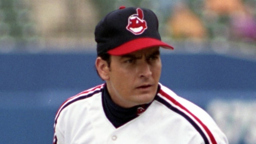 "BALTIMORE, MD - SEPTEMBER, 1993: Actor Charlie Sheen as Rick Wild Thing Vaughn #99 of the Cleveland Indians gets the sign for the next pitch from the catcher during the filming of the motion picture ""Major League II"" in September, 1993 at Camden Yards in Baltimore, Maryland. (Photo by: Diamond Images/Getty Images)"