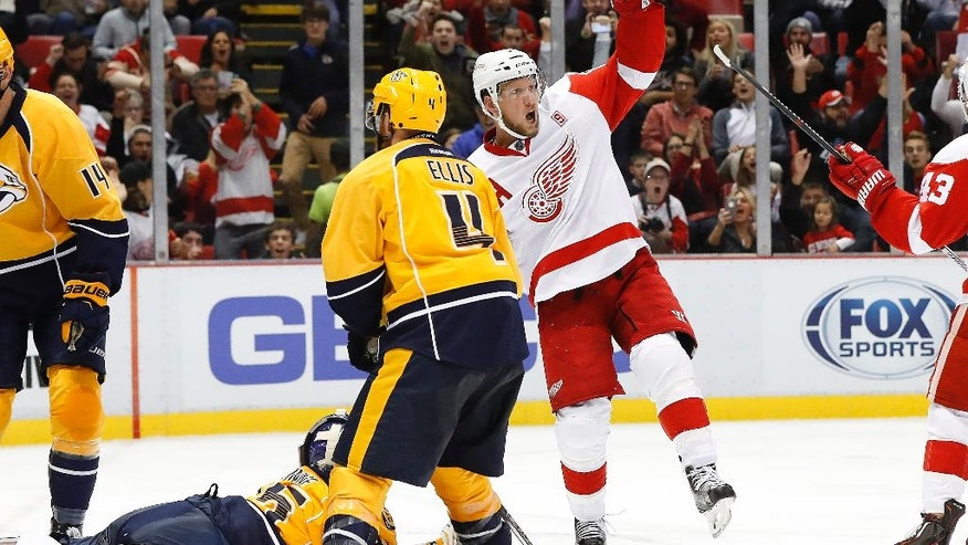 Detroit Red Wings left wing Justin Abdelkader (8) celebrates his goal against Nashville Predators goalie Pekka Rinne (35) during the second period of an NHL hockey game Friday, Oct. 21, 2016, in Detroit. (AP Photo/Paul Sancya)