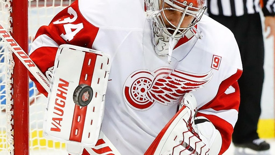Detroit Red Wings goalie Petr Mrazek stops a Nashville Predators shot in the first period of an NHL hockey game Friday, Oct. 21, 2016, in Detroit. (AP Photo/Paul Sancya)