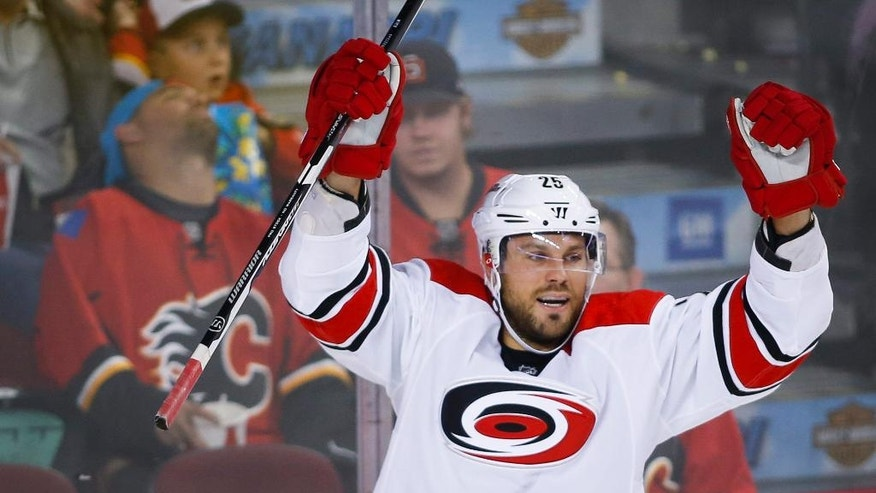 Carolina Hurricanes' Viktor Stalberg, from Sweden, celebrates his goal during the second period of an NHL hockey game against the Calgary Flames, Thursday, Oct. 20, 2016 in Calgary, Alberta. (Jeff McIntosh/The Canadian Press via AP)