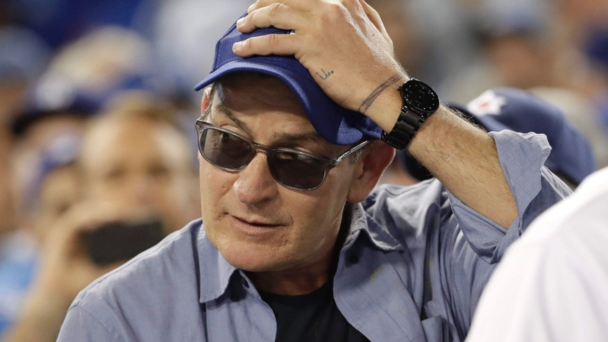 Actor Charlie Sheen reacts during the fifth inning of Game 4 of the National League baseball championship series between the Chicago Cubs and the Los Angeles Dodgers Wednesday, Oct. 19, 2016, in Los Angeles.