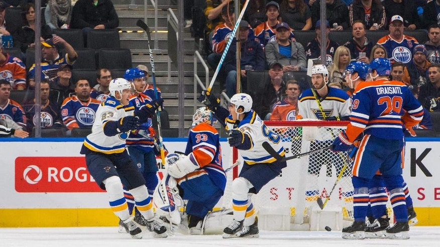 St. Louis Blues' Nail Yakupov (64) and Dmitri Jaskin (23) celebrate Yakupov's goal on Edmonton Oilers goalie Cam Talbot (33) as Oilers' Andrej Sekera (2) Tyler Pitlick (15) Leon Draisaitl (29) and Blues' Joel Edmundson (6) skate off during second-period NHL hockey game action in Edmonton, Alberta, Thursday, Oct. 20, 2016. (Amber Bracken/The Canadian Press via AP)