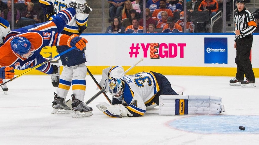 St. Louis Blues goalie Jake Allen (34) lets in a goal by Edmonton Oilers' Tyler Pitlick (15) during second-period NHL hockey game action in Edmonton, Alberta, Thursday, Oct. 20, 2016. (Amber Bracken/The Canadian Press via AP)