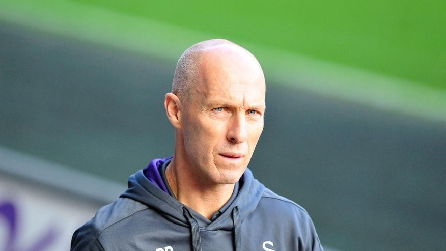 Swansea City Manger Bob Bradley walks beside the pitch before the English Premier League soccer match between Swansea City and Watford at the Liberty Stadium, Swansea, Wales, Saturday, Oct. 22, 2016. (Simon Galloway/PA via AP)