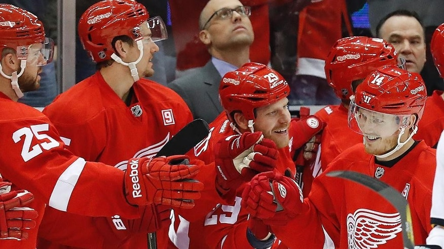 Detroit Red Wings right wing Gustav Nyquist (14) celebrates his goal against San Jose Sharks in the second period of an NHL hockey game in Detroit, Saturday, Oct. 22, 2016. (AP Photo/Paul Sancya)