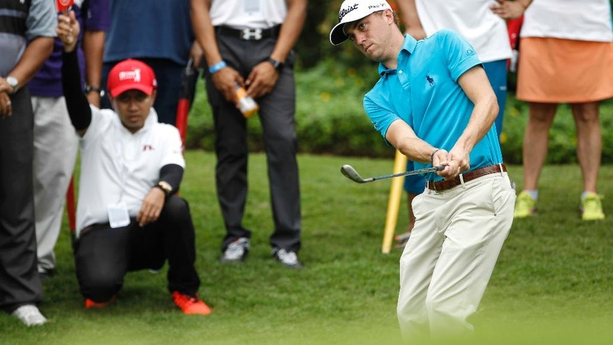 Justin Thomas of the United States watches his shot on the fifth green during the third round of the CIMB Classic golf tournament at Tournament Players Club in Kuala Lumpur, Malaysia, Saturday, Oct. 22, 2016. (AP Photo/Joshua Paul)