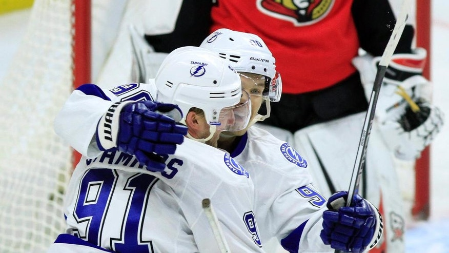 Tampa Bay Lighting's Steven Stamkos (91) celebrates his goal against the Ottawa Senators with teammate Vladislav Namestnikov (90) during the second period of an NHL hockey game Saturday, Oct. 22, 2016, in Ottawa, Ontario. (Fred Chartrand/The Canadian Press via AP)