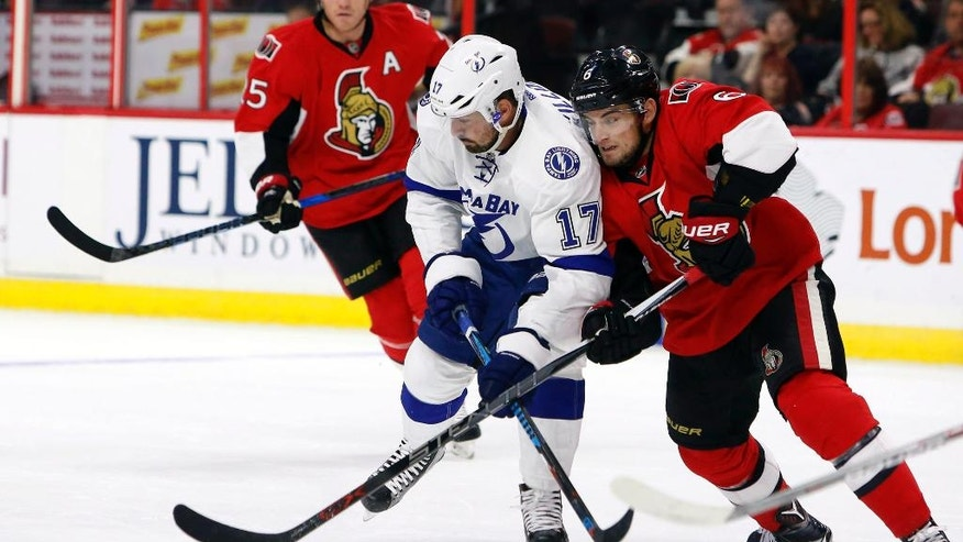 Ottawa Senators' Chris Widen (6) vies for the puck against Tampa Bay Lighting's Alex Killorn (17) during the first period of an NHL hockey game Saturday, Oct. 22, 2016, in Ottawa, Ontario. (Fred Chartrand/The Canadian Press via AP)
