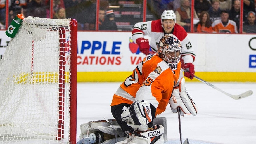 Philadelphia Flyers' Steve Mason, left, watches as the puck goes past him with Carolina Hurricanes' Jeff Skinner, right, coming toward him during the first period of an NHL hockey game, Saturday, Oct. 22, 2016, in Philadelphia. (AP Photo/Chris Szagola)