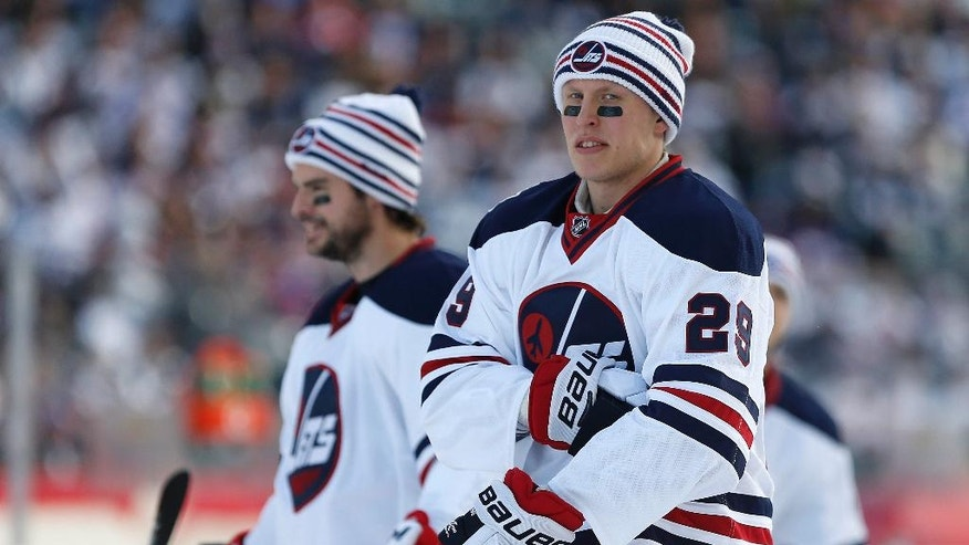 Winnipeg Jets' Drew Stafford (12) and Patrik Laine (29) during the warmup skate at the NHL Heritage Classic in Winnipeg, Manitoba, Sunday, Oct. 23, 2016. (John Woods/The Canadian Press via AP)