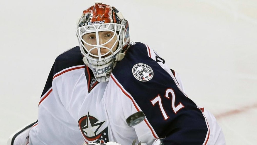 Columbus Blue Jackets golie Sergei Bobrovsky (72) deflects the puck during the second period of an NHL hockey game against the Dallas Stars on Saturday, Oct. 22, 2016, in Dallas. (AP Photo/LM Otero)