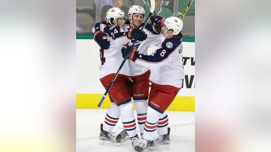 Columbus Blue Jackets right wing Josh Anderson (34) celebrates scoring a goal with teammates Boone Jenner (38) and Zach Werenski (8) during the second period of an NHL hockey game against the Dallas Stars on Saturday, Oct. 22, 2016, in Dallas. (AP Photo/LM Otero)