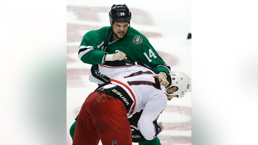 Dallas Stars left wing Jamie Benn (14) and Columbus Blue Jackets center Brandon Dubinsky (17) fight during the second period of an NHL hockey game Saturday, Oct. 22, 2016, in Dallas. (AP Photo/LM Otero)