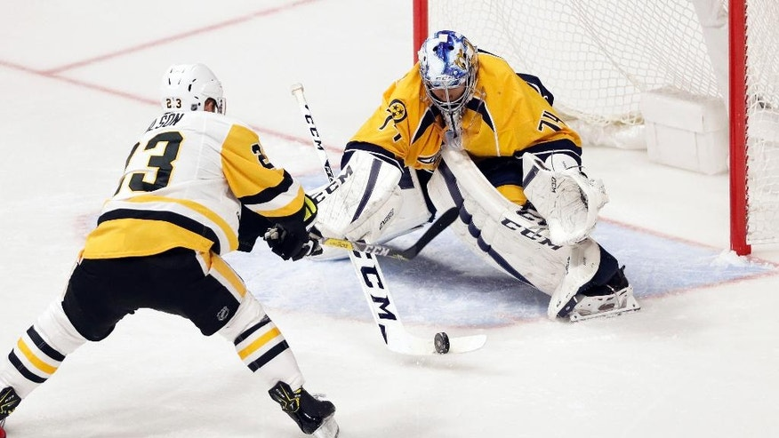 Nashville Predators goalie Juuse Saros (74), of Finland, blocks a shot by Pittsburgh Penguins left wing Scott Wilson (23) during the second period of an NHL hockey preseason game Saturday, Oct. 22, 2016, in Nashville, Tenn. (AP Photo/Mark Humphrey)