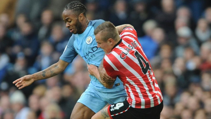Manchester City's Raheem Sterling, left, and Southampton's Jordy Clasie battle for the ball during the English Premier League soccer match between Manchester City and Southampton at the Etihad Stadium in Manchester, England, Sunday, Oct. 23, 2016. (AP Photo/Rui Vieira)