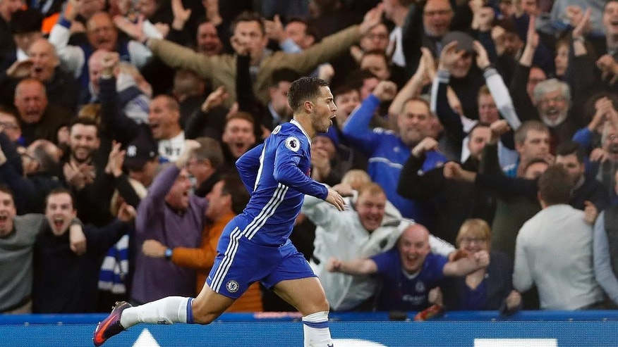 Chelsea's Eden Hazard celebrates after scoring during the English Premier League soccer match between Chelsea and Manchester United at Stamford Bridge stadium in London, Sunday, Oct. 23, 2016.(AP Photo/Kirsty Wigglesworth)