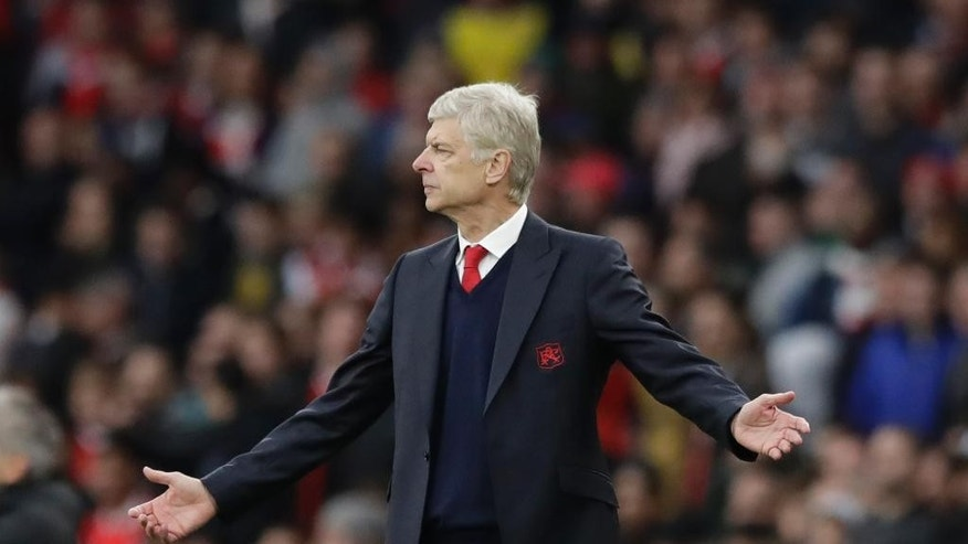 Arsenal's manager Arsene Wenger reacts during the English Premier League soccer match between Arsenal and Middlesbrough at the Emirates Stadium in London, Saturday, Oct. 22, 2016. (AP Photo/Matt Dunham)