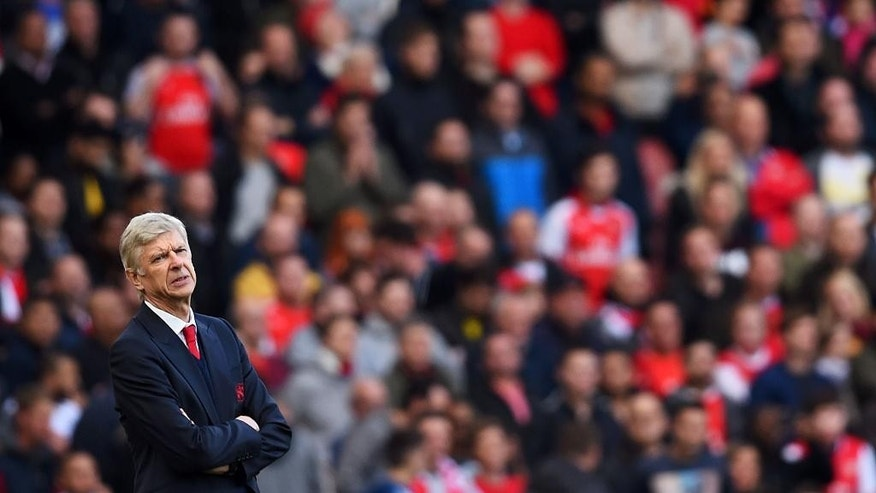 Arsenal manager Arsene Wenger stands beside the pitch before the English Premier League soccer match between Arsenal and Middlesbrough at the Emirates Stadium, London, Saturday, Oct. 22, 2016. (Dominic Lipinski/PA via AP)