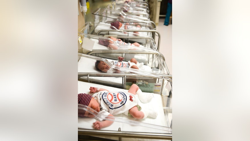 Unidentified babies wear World Series onesie at the Cleveland Clinic's Fairview Hospital in Cleveland Tuesday Oct. 25, 2016. Newborn babies at the Cleveland hospital have joined the ranks of the Cleveland Indians' fans. The clinic says babies born today and throughout the World Series at several of its hospitals will be dressed in the outfits to help cheer on the Indians' quest for a championship as they take on the Chicago Cubs. The first game of the series was set for Tuesday in Cleveland. (Cleveland Clinic via AP)