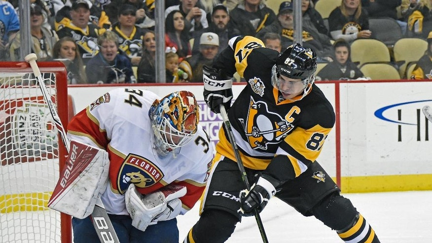 Florida Panthers goalie James Reimer (34) makes a save as Pittsburgh Penguins center Sidney Crosby (87) waits for a rebound during the second period of an NHL hockey game on Tuesday, Oct. 25, 2016, in Pittsburgh. (AP Photo/Fred Vuich)