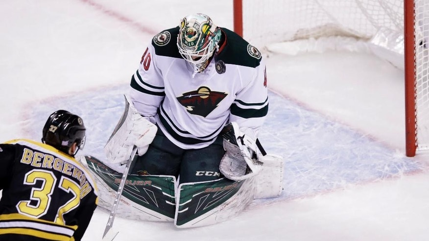 Minnesota Wild goalie Devan Dubnyk makes a save on a shot by Boston Bruins center Patrice Bergeron (37) during the first period of an NHL hockey game in Boston, Tuesday, Oct. 25, 2016. The Wild defeated the Bruins 5-0. (AP Photo/Charles Krupa)
